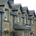 thick stone roofing slates and blue guttering on a country pub