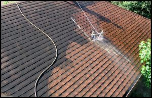 A roof being cleaned with a specialist low pressure washer