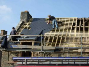 Slates being installed by roofing contractors